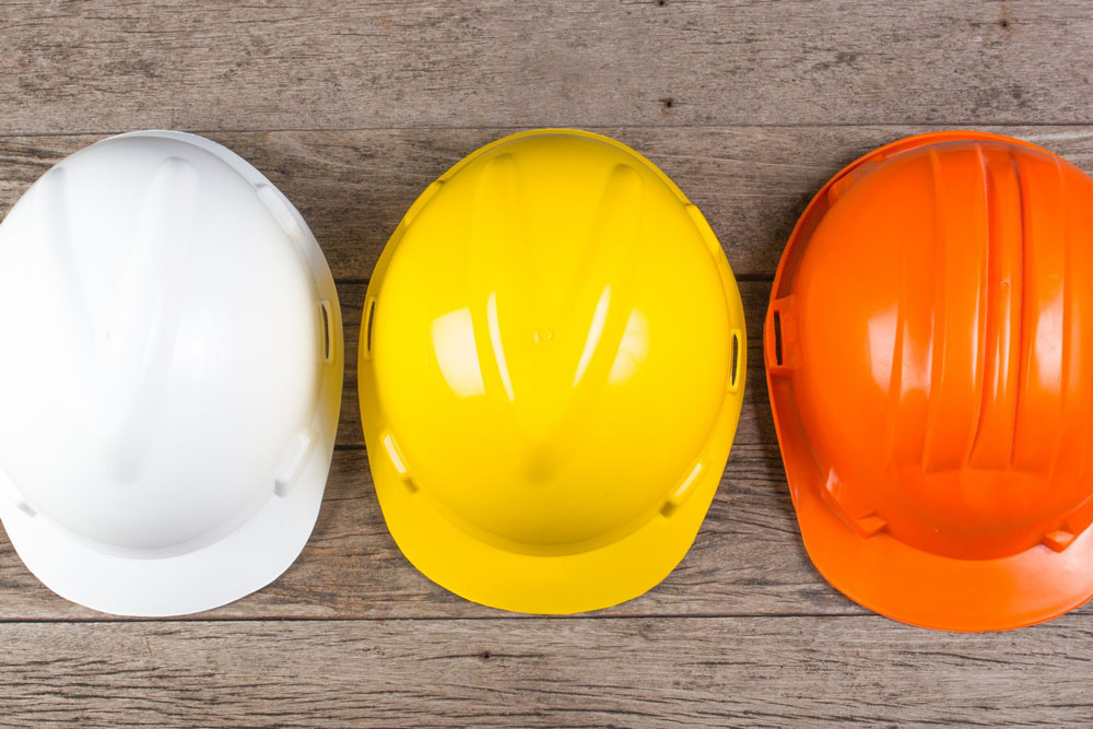 Three Construction Workers Safety Helmets