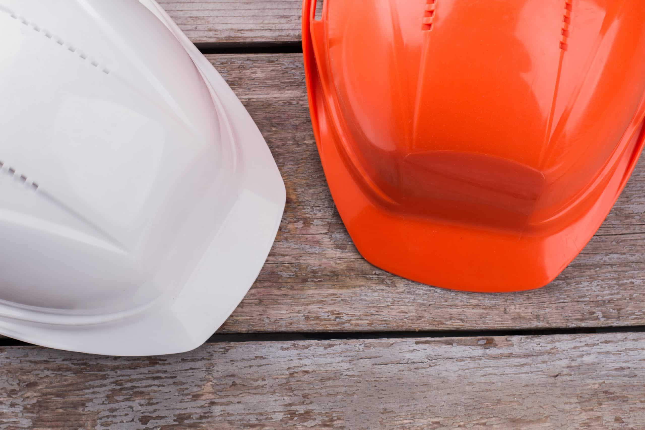 Two Construction Workers Safety Helmets